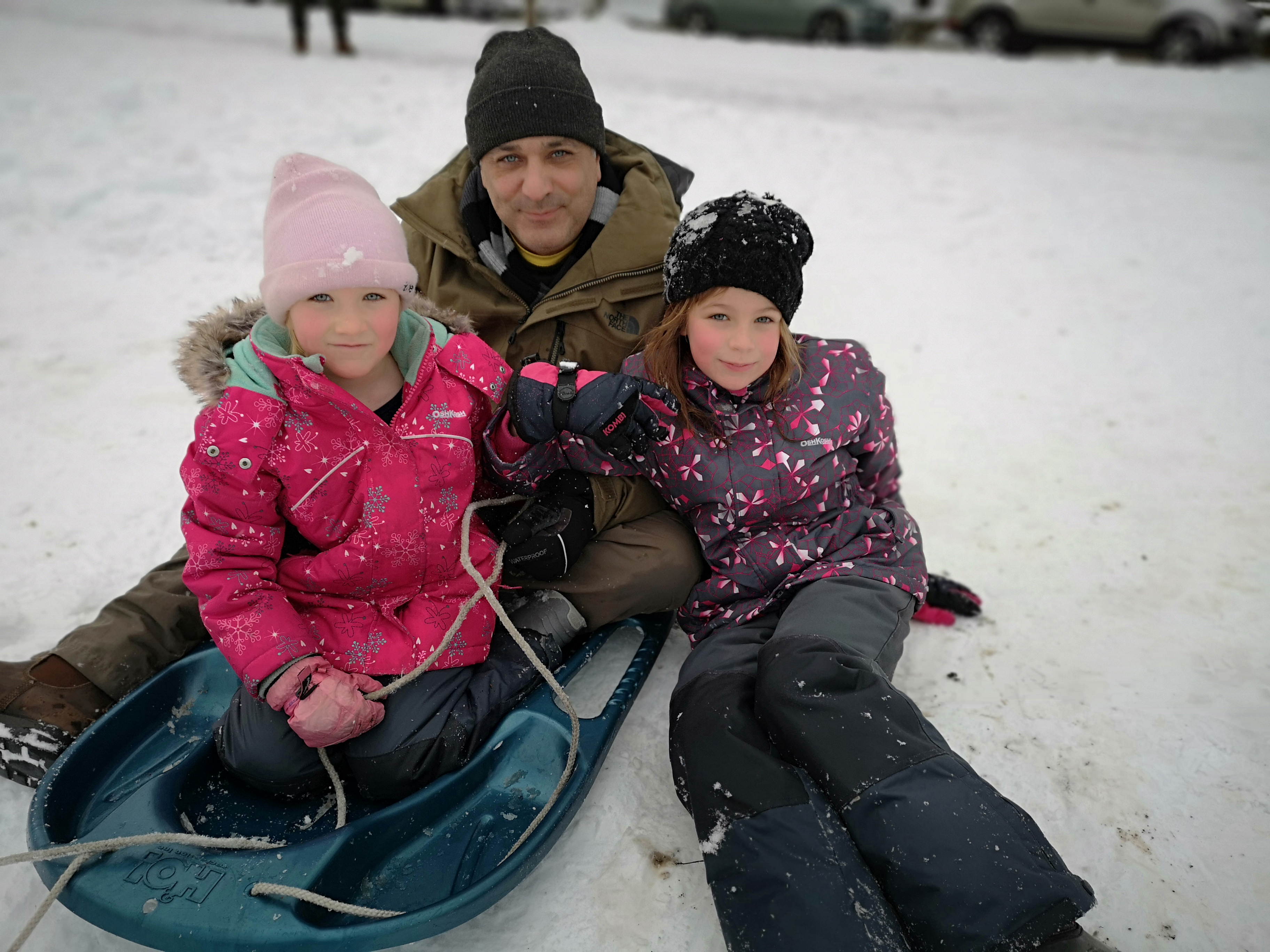 Stefan Linquist sledding with his                                 daughters